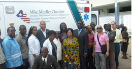 Members of MMC and JFK officials at ambulance donation ceremony